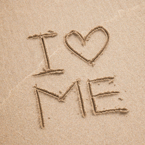 i love me written in the sand